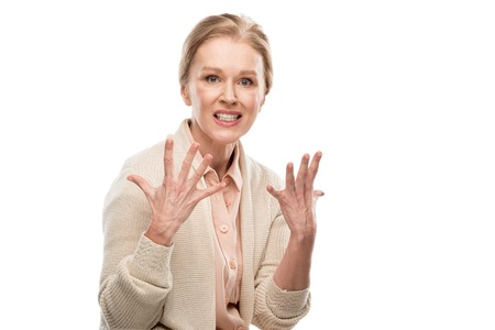 Stressed middle aged woman looking at camera and Gesturing isolated on white background