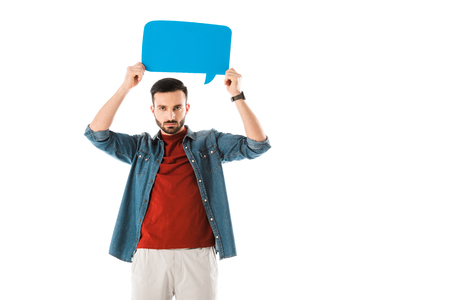 Serious man holding speech bubble above head and looking at camera isolated on white background Stock Photo