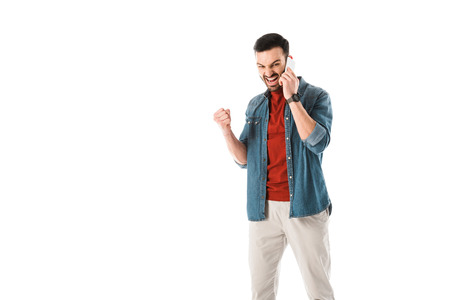 Irritated man quarreling and showing fist while talking on smartphone isolated on white background