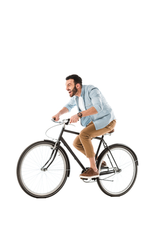 Angry bearded man screaming while riding bicycle isolated on white background Stock Photo