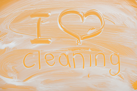 I love cleaning handwritten lettering written on glass with white foam on orange background