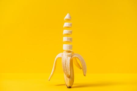 Sliced nutritious tasty fresh banana isolated on yellow background