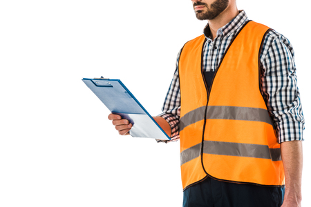 Partial view of construction worker in safety vest holding clipboard isolated on white background