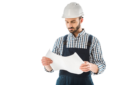 Concentrated construction worker in helmet looking at building plan isolated on white background