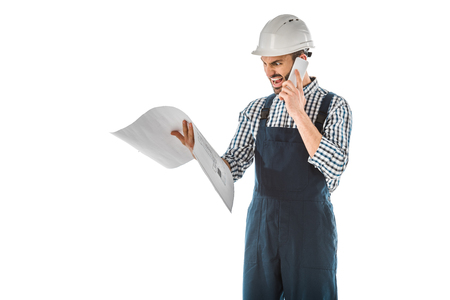 Irritated foreman yelling while talking on smartphone and holding building plan isolated on white background