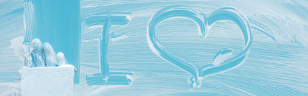 Panoramic shot of cleaner with sponge near i love lettering on glass with white foam on blue background Stok Fotoğraf