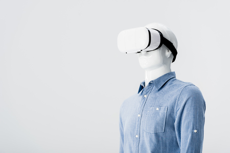 plastic mannequin in clothes with Virtual reality headset isolated on grey with copy space
