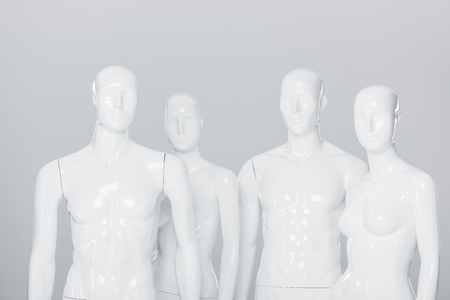 white plastic mannequin dummies isolated on grey
