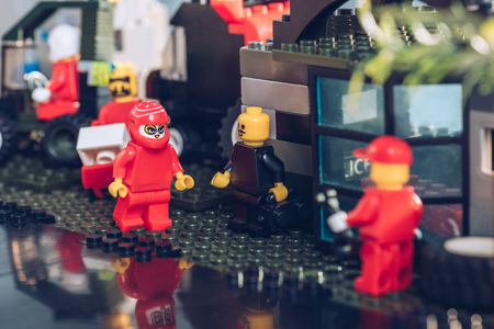 KYIV, UKRAINE - MARCH 15, 2019: Selective Focus of lego minifigures working at service station