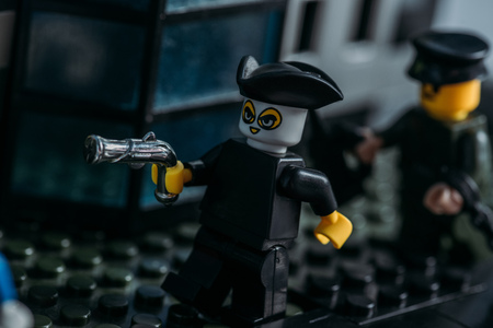 KYIV, UKRAINE - MARCH 15, 2019: selective focus of lego pirate figurine in hat and mask holding gun Stock Photo