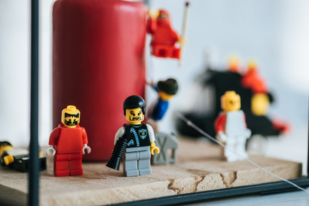 KYIV, UKRAINE - MARCH 15, 2019: selective focus of lego characters standing near candle with copy space 報道画像