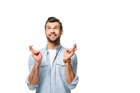 excited man with fingers crossed Isolated On White Stock Photo