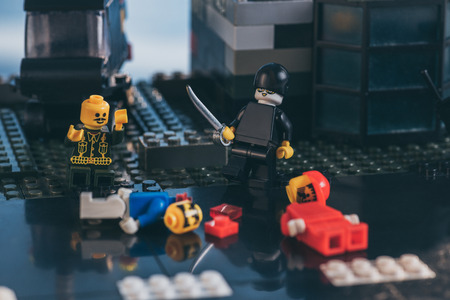 KYIV, UKRAINE - MARCH 15, 2019: lego figurines during fight scene on lego blocks Editorial