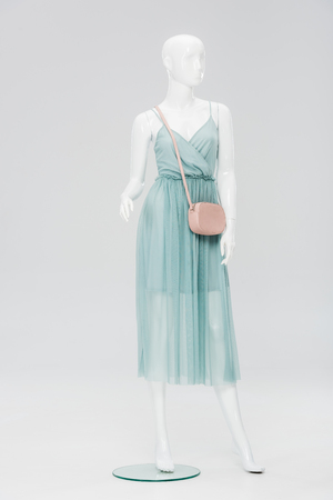 plastic mannequin with bag and dress isolated on grey Zdjęcie Seryjne - 123589027