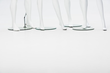 white plastic mannequin legs on white with copy space