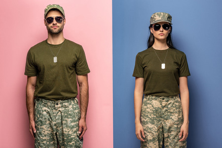 man and woman in military uniform and sunglasses on blue and pink