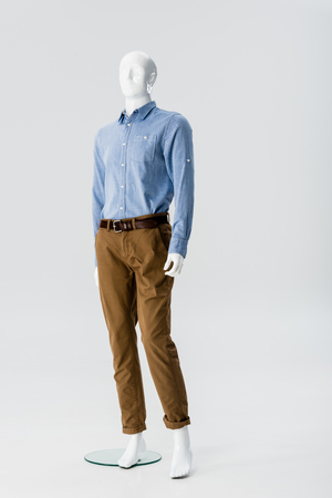 white plastic mannequin in clothes isolated on grey
