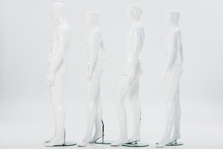 white plastic mannequins in row on white