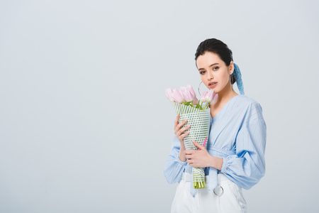 beautiful stylish girl with bouquet of tulips isolated on grey with copy space Stok Fotoğraf