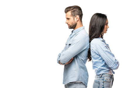 upset man and young woman standing back to back with crossed arms Isolated On White
