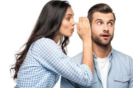 young woman telling secret to shocked man Isolated On White