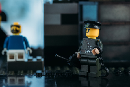 KYIV, UKRAINE - MARCH 15, 2019: selective focus of policeman lego figurine in hat and black uniform Archivio Fotografico - 123680863