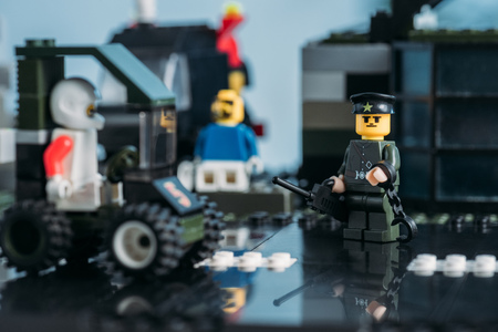 KYIV, UKRAINE - MARCH 15, 2019: Selective Focus of lego policeman figurine with handcuffs