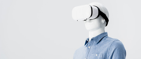panoramic shot of mannequin in clothes with Virtual reality headset isolated on grey with copy space Stock Photo - 123661633