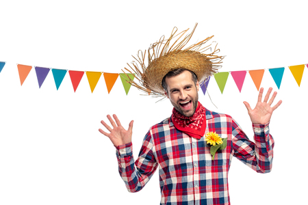 happy man in Straw Hat Gesturing near festive garland Isolated On White