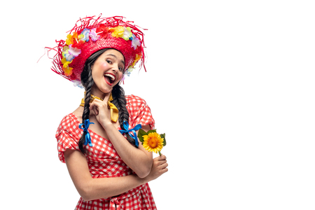 excited girl in festive clothes and Straw Hat touching chin Isolated On White