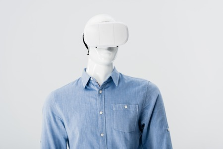 mannequin in clothes with Virtual reality headset isolated on grey Stock Photo