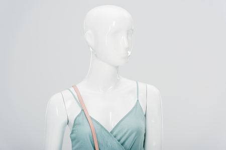 plastic mannequin in dress isolated on grey