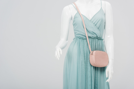 mannequin with bag and dress isolated on grey with copy space