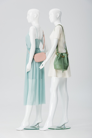 mannequins with bags and dresses isolated on grey Stock Photo
