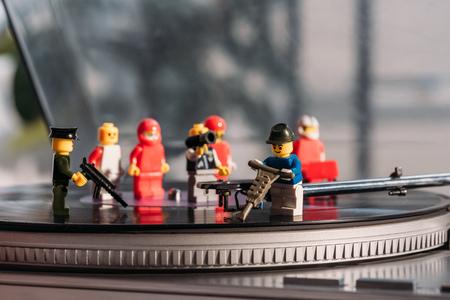 KYIV, UKRAINE - MARCH 15, 2019: selective focus of plastic lego figurines fixing vinyl record player
