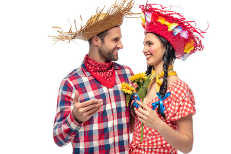 happy man and young woman in festive clothes with sunflowers isolated on white