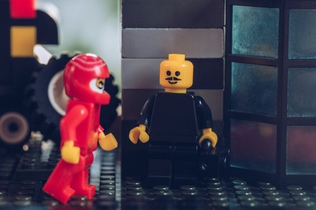 KYIV, UKRAINE - MARCH 15, 2019: close up of lego minifigure with moustache and motorcyclist figurine in red