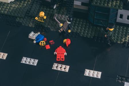 KYIV, UKRAINE - MARCH 15, 2019: lego figurines during fight scene on black lego blocks