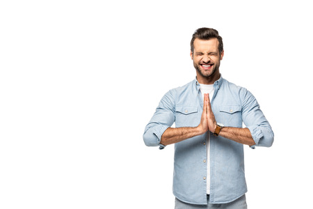 handsome excited man doing please gesture Isolated On White Reklamní fotografie