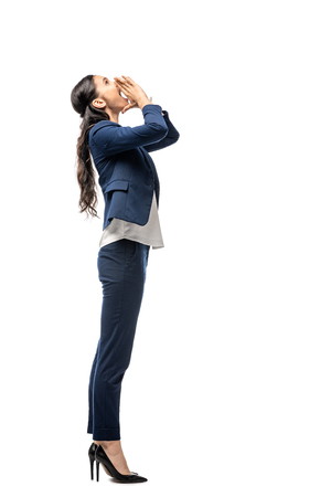 beautiful businesswoman in suit shouting Isolated On White with copy space 스톡 콘텐츠