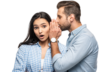 man telling secret to shocked young woman Isolated On White