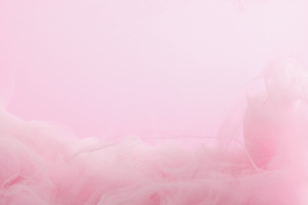 Close up view of pink paint mixing in water isolated on pink Banque d'images - 123639162
