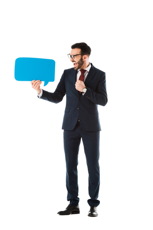 excited businessman in black suit holding speech bubble isolated on white