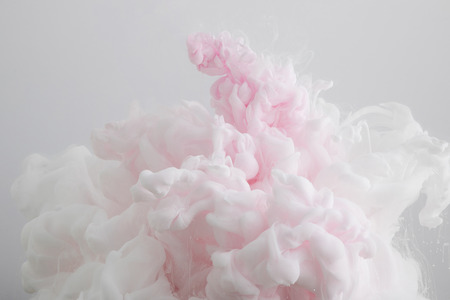 Close up view of light pink paint splash isolated on grey Banco de Imagens