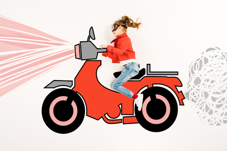 Top view of happy kid in super hero mask driving motorbike on white background.