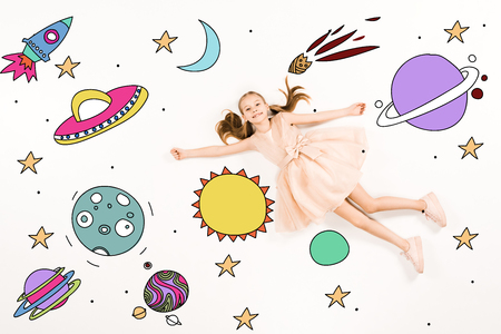 Top view of cheerful kid in pink dress flying in space on white background