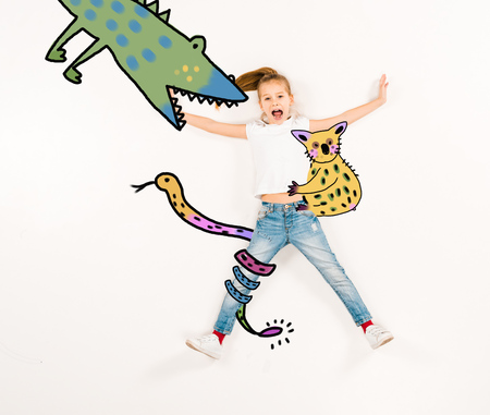 Top view of scared kid screaming near fairy characters on white background