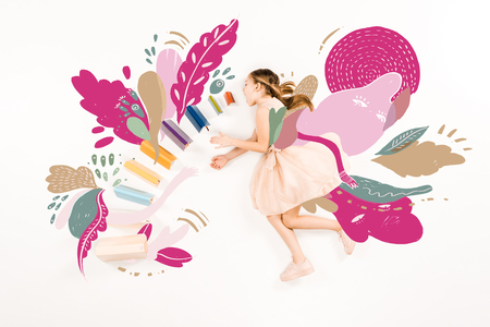 Top view of cute kid in pink dress flying with open mouth near books on white background