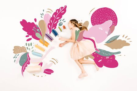 Top view of cute kid in pink dress flying with open mouth near books isolated on a white background