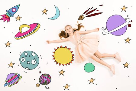 Top view of cheerful kid in pink dress flying in space isolated on a white background